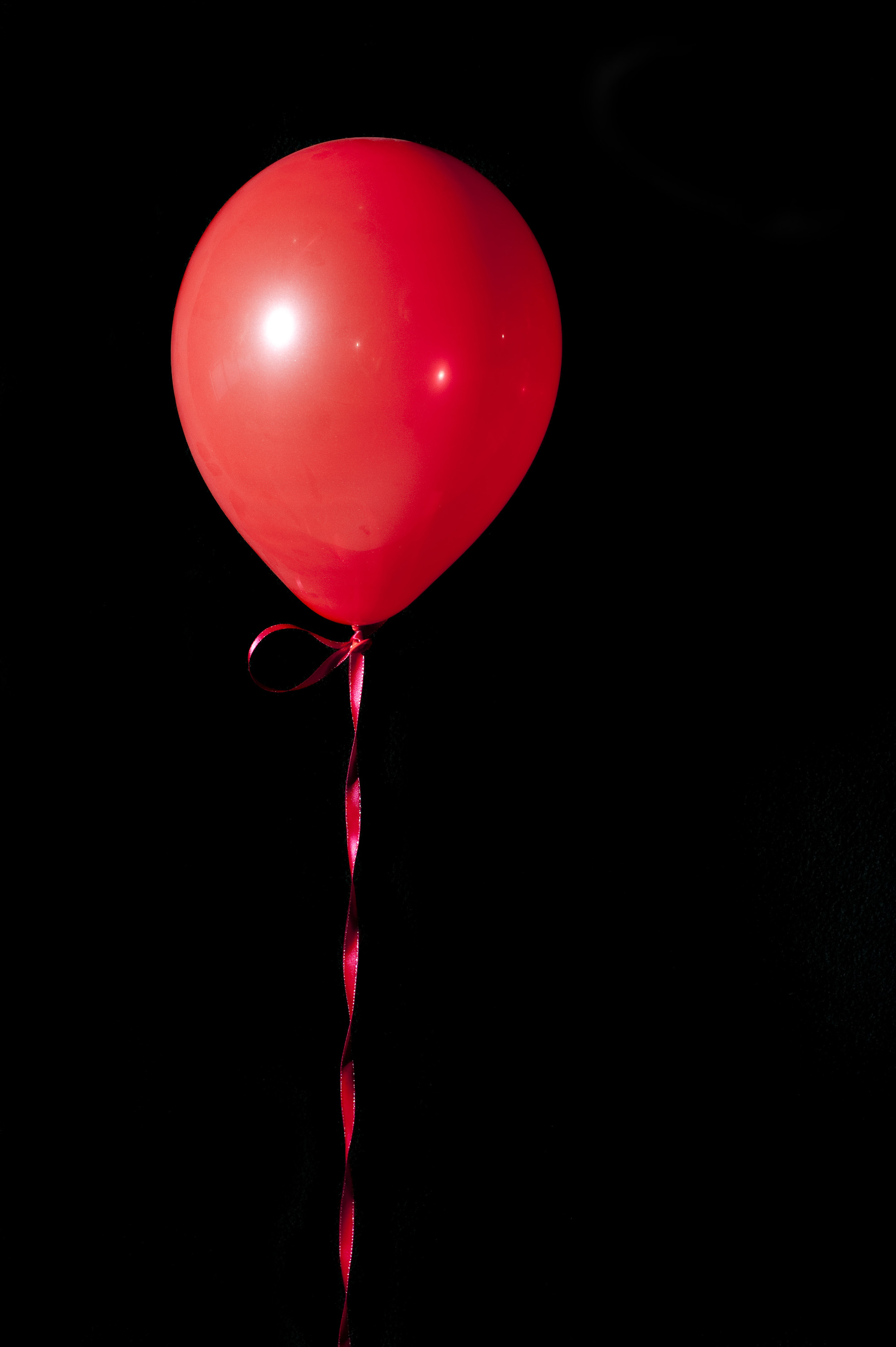 red floating balloon